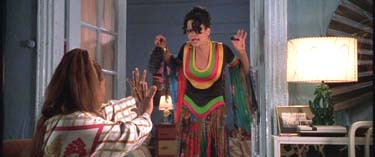 Louise (Da Brat) attempts to ward off the Ghost of Fashion Disasters Past.